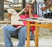 Reading the news. by Anne Scantlebury