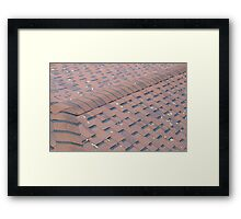 Top view of brown roof shingles with a few fallen leaves Framed Print
