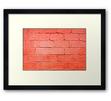 Red background of bricks with a layer of paint closeup Framed Print