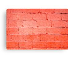 Red background of bricks with a layer of paint closeup Canvas Print