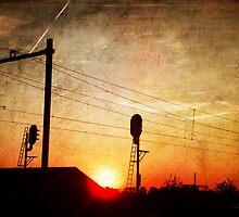 Railroad Sunset by Yvon van der Wijk