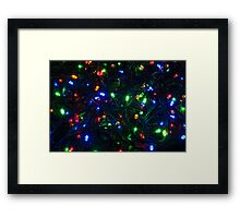 Illuminated closeup of tangled Christmas lights Framed Print
