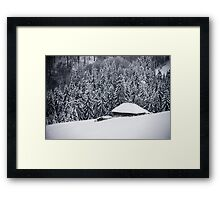 Wooden house in the snow Framed Print