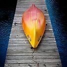 Kayak on a dock by Mooke