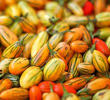Fresh organic tomatoes at local farmers market by ieatstars