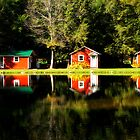 Three Red Cabins Reflection by KellyHeaton