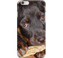 Rottweiler Puppy Chewing a Treat iPhone Case/Skin