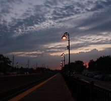 An early morning Sunrise at the Lisle, IL train station. by Adam Kuehl