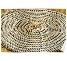 A Rope in circles on a straight wooden floor. Poster