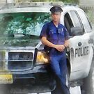 Policeman by Patrol Car by Susan Savad