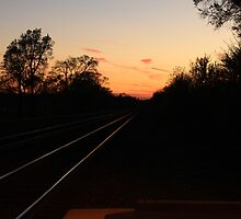 Western sky beyond the train tracks leaving Lisle, IL by Adam Kuehl