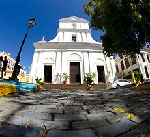 A fisheye street level view of a cathedral in Old San Juan, PR. by Sven Brogren