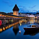luzern wood bridge swiss night by arthit somsakul