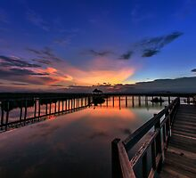 beautiful sky on wood bridge by arthit somsakul