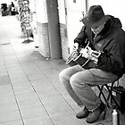 Man Playing His Guitar on a Subway Platform. by briceNYC