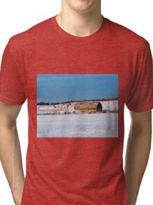 Barn gets a little glow from the Sun as it sits, waiting to be torn apart. Tri-blend T-Shirt