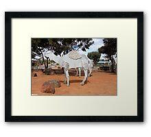 Tin Camels Framed Print