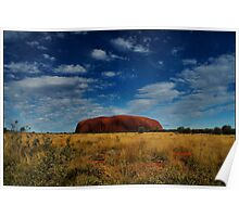 Ayers Rock under a cloudy blue sky - not common Poster