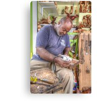 Bahamian Sculptor carving the Wood Canvas Print