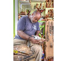 Bahamian Sculptor carving the Wood Photographic Print
