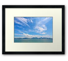 Seascape in Hong Kong at summer time, with moving clouds. Framed Print