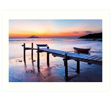 Sunset coast at wooden pier Art Print