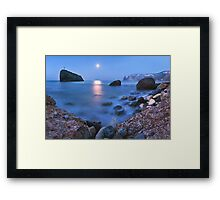 Coast rock with cross on moonrise Framed Print