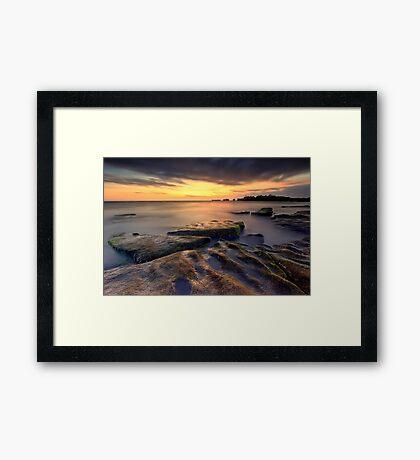 Sunset at the rocky beach Framed Print