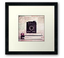 Retro - Vintage Black Camera on Beige Background and books  Framed Print