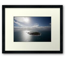 Aerial view of Snapper Island, Queensland, Australia with white cloud formations and blue ocean Framed Print