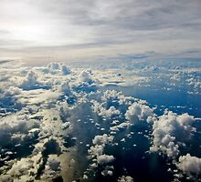 Aerial view of white cloud formations and blue ocean by Sharpeyeimages
