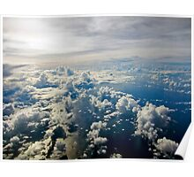 Aerial view of white cloud formations and blue ocean Poster