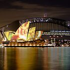 Sydney Opera House with colour display on roof and Harbour Bridge at night, Sydney, Australia by Sharpeyeimages