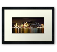 Sydney Opera House with colour display on roof and Harbour Bridge at night, Sydney, Australia Framed Print