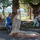 Mending nets, San Feliciano, Lago Trasimeno, Umbria by Andrew Jones