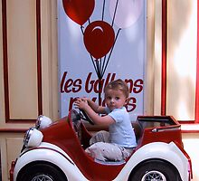Driving his first car by Esmé Lammers