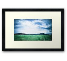 A Green Field under Turbulent Clouds and Sky Framed Print