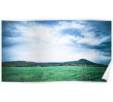 A Green Field under Turbulent Clouds and Sky Poster
