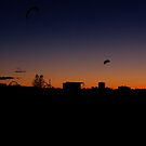 Parachute kites at sunset by AndreCosto
