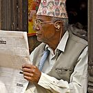 Reading the news by Konstantinos Arvanitopoulos