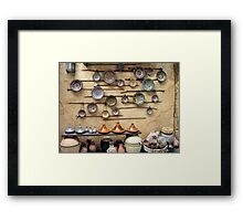 Pottery display in a Persian market Framed Print