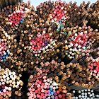Rainbow-colored bundles of steel rebar by Jeff Knapp