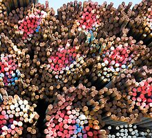 Rainbow-colored bundles of steel rebar by Jeff Knapp