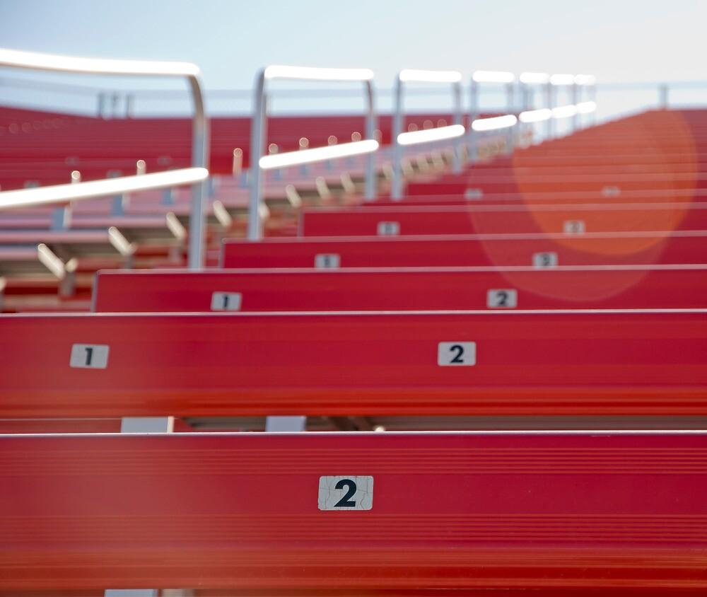 Red stadium seating by Jeff Knapp