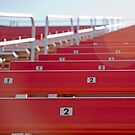 Red stadium seating by Jeff Knapp