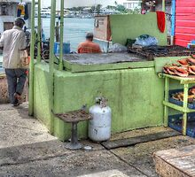 Fishermen selling conchs at Potter's Cay - Nassau, The Bahamas by 242Digital