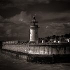 Lighthouse before the storm  by Ian Hufton