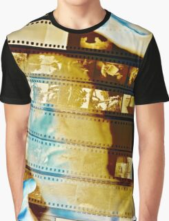 Photographer looks at a sheet of negatives Graphic T-Shirt