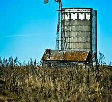 abandoned rural farm windmill by Roxanne Weber