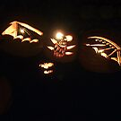 A Bat Comes Flying By!  No.. these are carved pumpkins hanging in a tree! by Jane Neill-Hancock